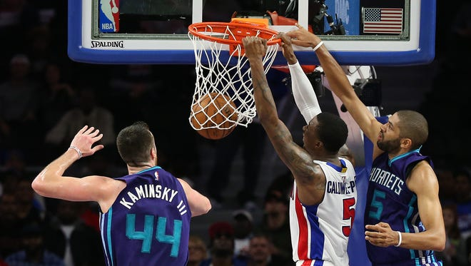Pistons guard Kentavious Caldwell-Pope dunks during the fourth quarter of the Pistons' 114-108 overtime win over the Hornets on Thursday, Feb. 23, 2017 at the Palace.