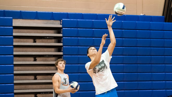 Ty Holsopple gets ready to serve the ball during volleyball tryouts on Tuesday, March 7, 2017 in Chambersburg, Pa. Superintendent Joe Padasak suggested seven ideas to help cut costs in CASD, one of which is to eliminate some athletics programs at the middle schools and high school, to save up to $1 million or more.