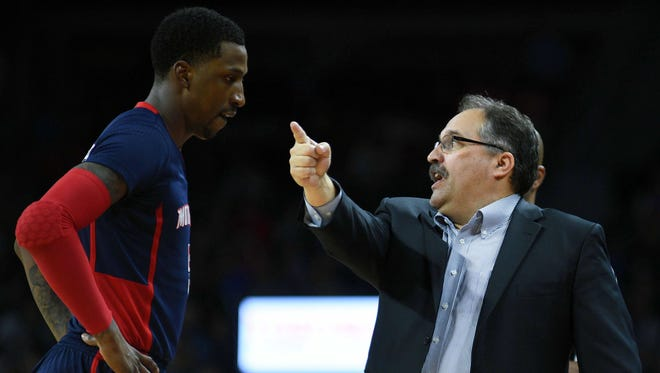 Pistons coach Stan Van Gundy talks to guard Kentavious Caldwell-Pope late in the Pistons' 112-95 win over the Suns on March 19, 2017 at the Palace.