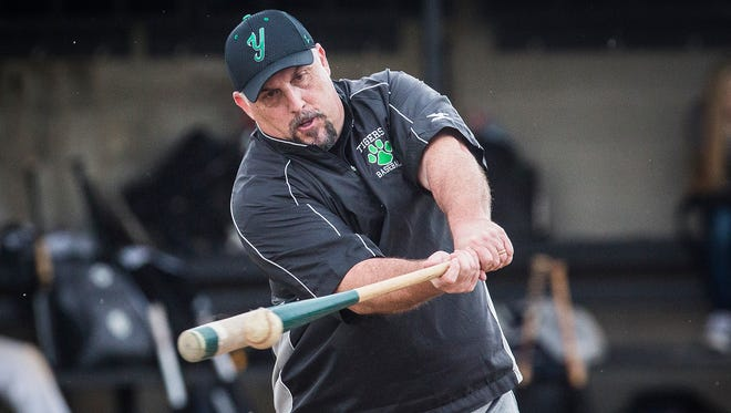 Yorktown baseball coach PJ Fauquher hits for his players during practice at Yorktown High School Thursday, April 13, 2017.