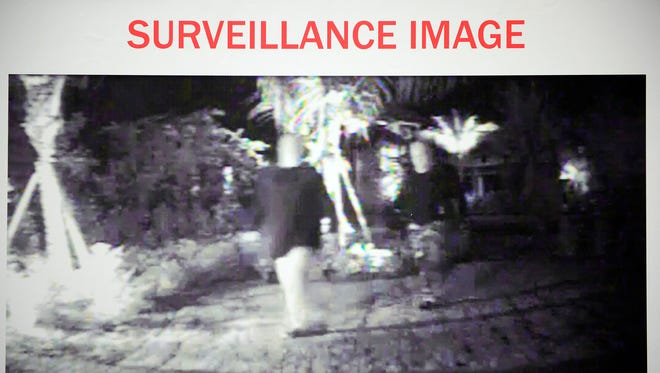A screen capture of surveillance footage is displayed Monday, Oct. 6, 2014, at Collier County's Sheriffs Office Professional Development Center in Naples, Fla. The Collier/Naples Regional Home Invasion Task Force, along with Florida Attorney General Pam Bondi's Office of Statewide prosecution announced, in a press conference, that five men are being charged in connection with five high-end home-invasion robberies in the county occurring  this year.