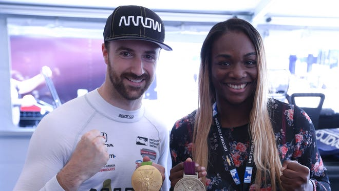 James Hinchcliffe, driver of the Schmidt Peterson Motorsports No. 5 Honda, poses with two-time Olympic boxing gold medalist Claressa Shields in the pit area after IndyCar practice for the Chevrolet Detroit Grand Prix on Friday, June 2, 2017 on Belle Isle in Detroit.
