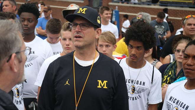 Michigan coach Jim Harbaugh meets high school players during the Michigan Football Elite Camp on June 23, 2017, at Michigan Stadium.