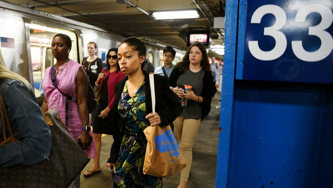 Additional commuters funnel through the 33rd Street PATH station in Manhattan on Monday, rerouted through Hoboken due to the beginning of repairs at New York Penn Station.