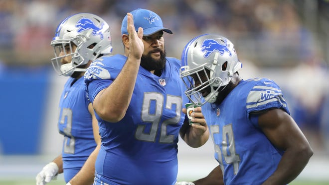 Haloti Ngata, left, congratulates Steve Longa in the second quarter of the Lions' 16-6 exhibition win over the Jets on Aug. 19, 2017, at Ford Field.