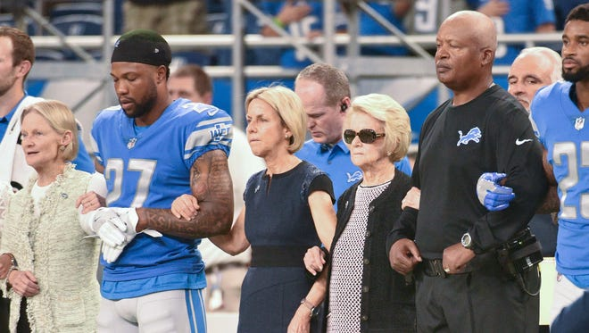 Lions owner Martha Ford stands with coach Jim Caldwell and players during the national anthem before the game against the Falcons at Ford Field on Sept. 24, 2017.