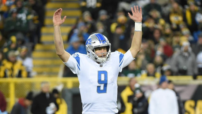 Lions quarterback Matthew Stafford celebrates after throwing a touchdown pass in the fourth quarter against the Packers at Lambeau Field, Monday, Nov. 6, 2017.