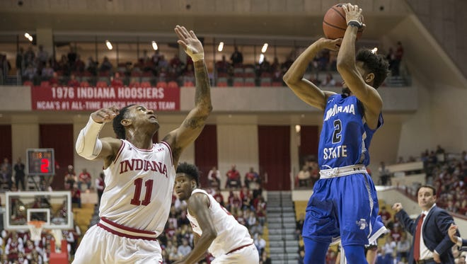 Jordan Barnes of Indiana State University puts up a first half three point shot as he is guarded by Devonte Green of Indiana University during action against Indiana State University, Assembly Hall, Bloomington, Friday, Nov. 10, 2017.
