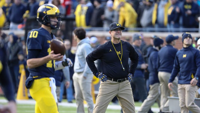 Michigan head coach Jim Harbaugh watches his players go through drills before action against Ohio State on Saturday, November 25, 2017 at Michigan Stadium in Ann Arbor.