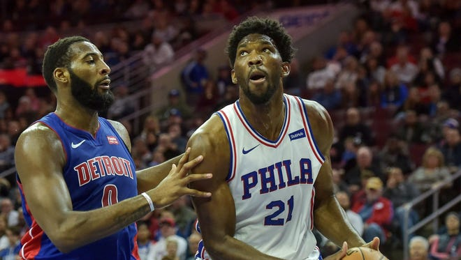 76ers center Joel Embiid looks to shoot as Pistons center Andre Drummond defends during the second quarter of the Pistons' 108-103 loss on Saturday in Philadelphia.