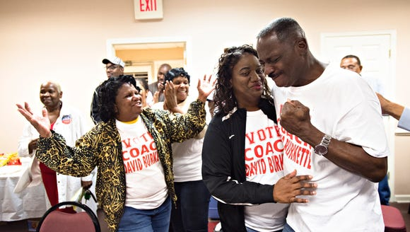 David Burkette is embraced by his wife, Linda, after finding out he had won the State Senate District 26 Democratic run off election on Tuesday, Feb. 27, 2018, in Montgomery, Ala. A bill before the Legislature would end special elections like the one currently taking place for the seat.