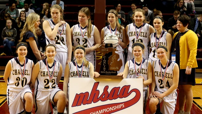 Chassell poses with their runner up trophy after Lenawee Christian's 57-36 win in the Class D state final at Van Noord Arena at Calvin College in Grand Rapids on Saturday, March 17, 2018.