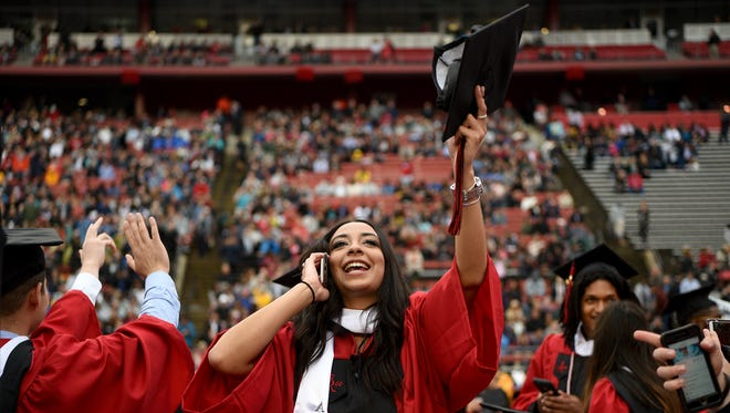 The 252nd commencement of Rutgers University was held at High Point Solutions Stadium in Piscataway on Sunday, May 13, 2018. Ileana Pereira of River Edge, waves to her family.