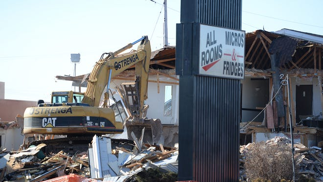 An excavator brings down the Road Star Inn at 1941 True Lane in Green Bay on Tuesday.