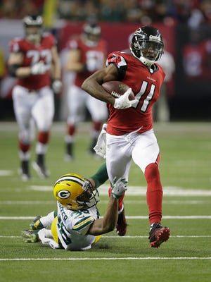 Packers cornerback LaDarius Gunter can't stop Falcons wide receiver Julio Jones from scoring a touchdown in the second half Sunday in the  NFC Championship Game.