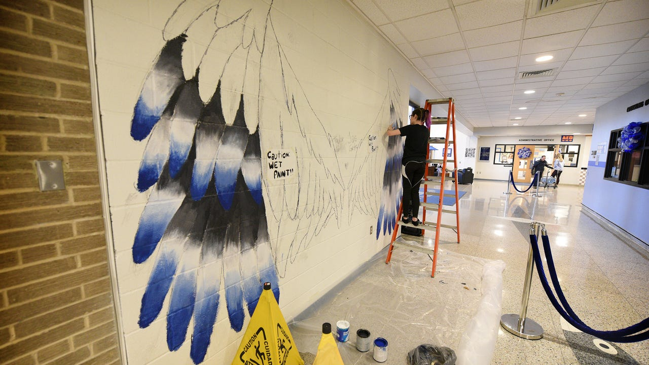 "Cedar Crest High School artist's Jae Getz and Taylor Gunnells are creating a mural of the school's mascot that is designed  ""specifically so you can stand in front of them and take a picture.""  The mural, being painted in the lobby near the main entrance will take about two weeks to finish."