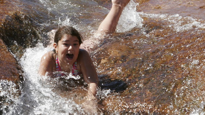 Slide Rock State Park in the Sedona-Village of Oak Creek area, is one of Arizona's most popular destinations when the weather turns warm.