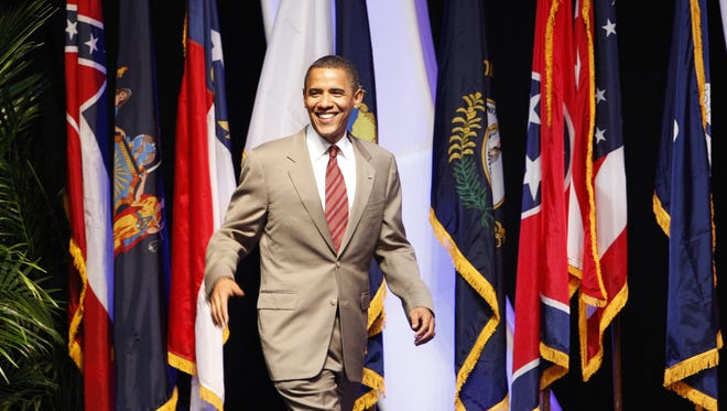 In this 2008 photo, Democratic presidential candidate Barack Obama wears a big smile as he is greeted by supporters during the NAACP National Convention, which was held at the Duke Energy Convention Center in downtown Cincinnati.
