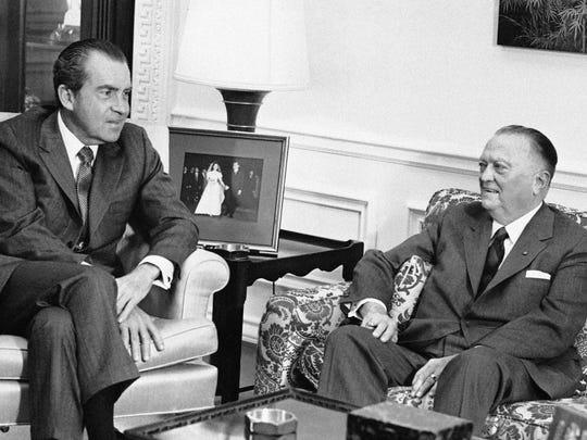 President Richard Nixon meets with FBI Director J. Edgar Hoover on Dec. 31, 1971.