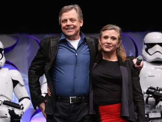 Actors Mark Hamill (L) and Carrie Fisher speak onstage