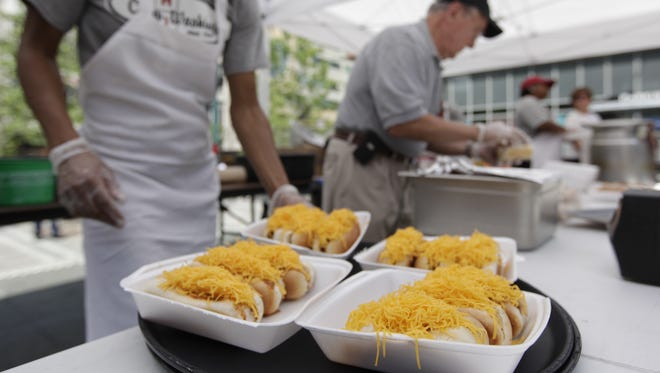 Coneys are assembled by Camp Washington Chili staff at Fountain Square at a past event.