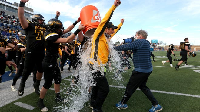 Andale head coach Dylan Schmidt has ice water poured over him after his team won the Class 3A state championship game at Gowans Stadium in Hutchinson last fall. Andale beat Perry-Lecompton, 20-0, for the title.