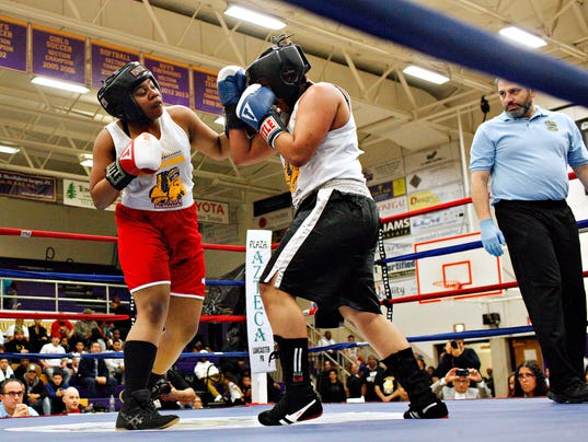 female boxer Golden Gloves bout match