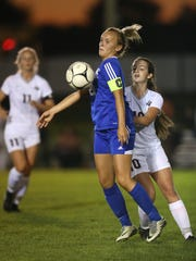 Wheatland-Chili's Hannah Callaghan controls the ball ahead of  Byron-Bergen's Julia Menzie.