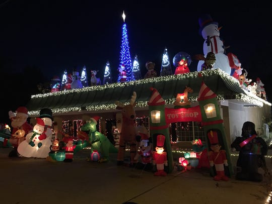 Dr. Dan Holt's Christmas display takes up to buildings