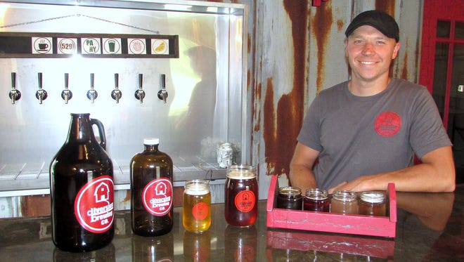 "Dustin ""Dutch"" Blokzyl, co-owner of Diversion Brewing Co. in Chemung, shows off some of the craft beers that will be available for sampling during this weekend's grand opening."