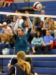 Siegel's Julia Wheeler (13) defends the net against