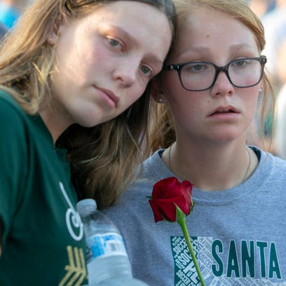 Students embrace during a vigil for victims of the
