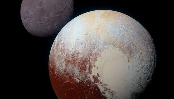 The heart  shape on Pluto, here with its moon Charon, was named Tombaugh Regio  for Pluto's discoverer, Clyde Tombaugh.