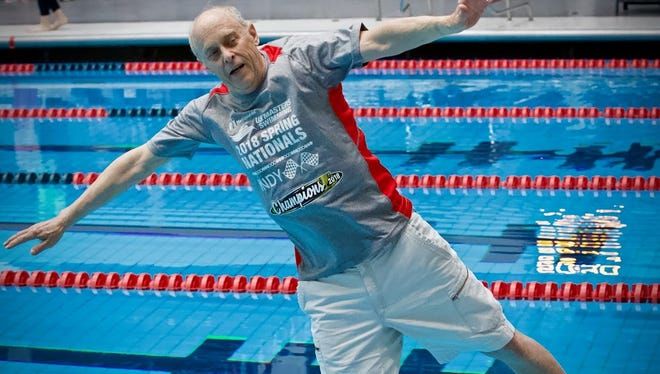 Fred Russell is thrown into the pool after his team won the U.S. Masters Swimming 2018 Spring Nationals.