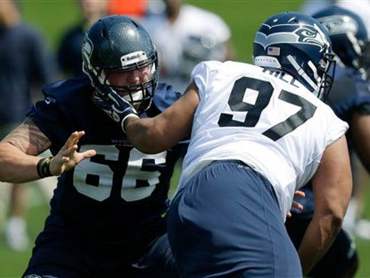 Former Nittany Lion Jordan Hill (97) is blocked by Seattle's Jared Smith during the Seahawks' recent rookie minicamp. in Renton, Wash. (Associated Press/Ted S. Warren)