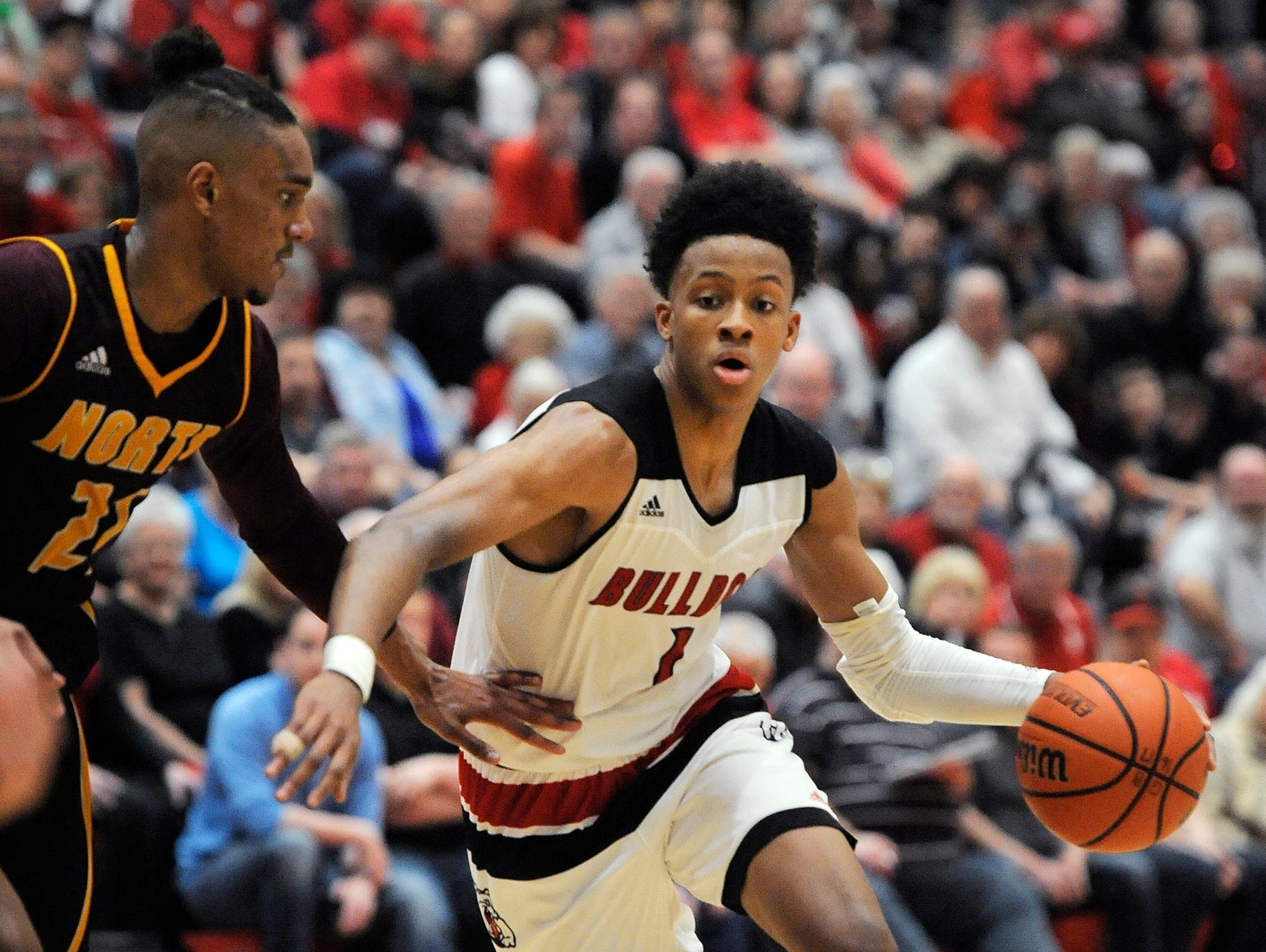 New Albany's Romeo Langford (right) drives against Bloomington North's Musa Jallow (left) on Friday at New Albany High School. Feb. 24, 2017