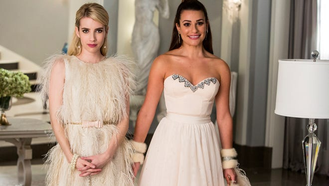 """Chanel No. 1 (Emma Roberts, left) decided to make Hester (Lea Michele) over into Chanel No. 6 because """"I need minions and I'm running out of Chanels!"""""""