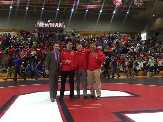 From left, Cornell wrestling coach Rob Koll, Cam Simaz, Kyle Dake and Steve Bosak. Simaz, Dake and Bosak were inducted into Cornell's Hall of Distinguished Wrestling Alumni on Sunday, Feb. 7, 2016, and recognized during halftime of Cornell's dual meet against Oklahoma State.