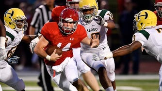 Brentwood Academy's Conner Woodlee (14) advances against Hillsboro during the first half at Brentwood Academy in Brentwood, Tenn., Friday, Aug. 18, 2017.
