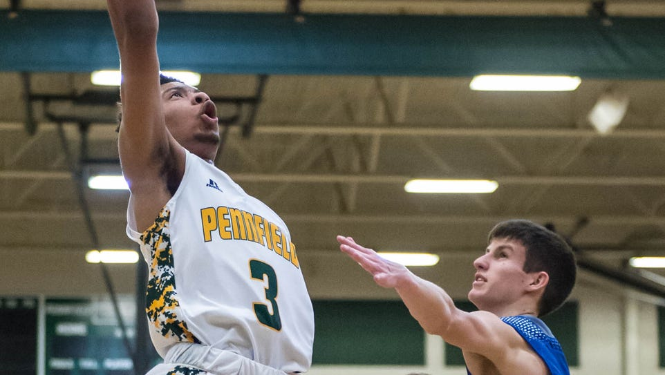 Pennfield's Ronald Jamierson (3) goes for the layup