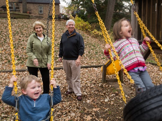 KCCI's Mollie and Kevin Cooney play with their grandchildren