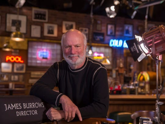 Legendary director James Burrows stands on the set