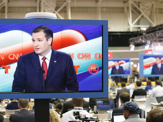 Ted Cruz is seen on television in the CNN filing room