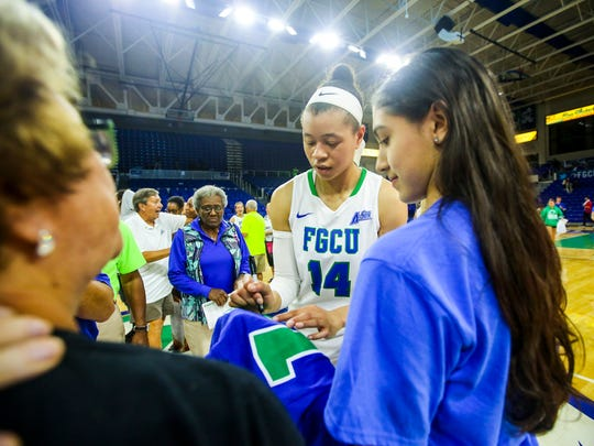 Fans congratulate the players after the game. FGCU's Whitney Knight signs a T-shirt.  The FGCU women's basketball team played Bethune-Cookman, in their first round game in the Women's NIT. The game was played in Alico Arena, Fort Myers, Florida, Friday, March 18, 2016.