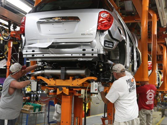 Robert Honaker (l to r), William Stewart and Doug Cain assemble a Chevrolet Equinox in 2014 at the General Motors Spring Hill, Tenn. complex. GM said it will build the new Cadillac XT6 SUV there.
