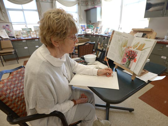 Patricia Clapp learned to paint with her left hand after stroke left her right arm paralyzed. Patricia sketches in preparation to paint in Pequannock NJ. Feb. 16, 2017.