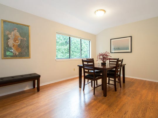 After staging: The dining room in Hal Workin's condominium