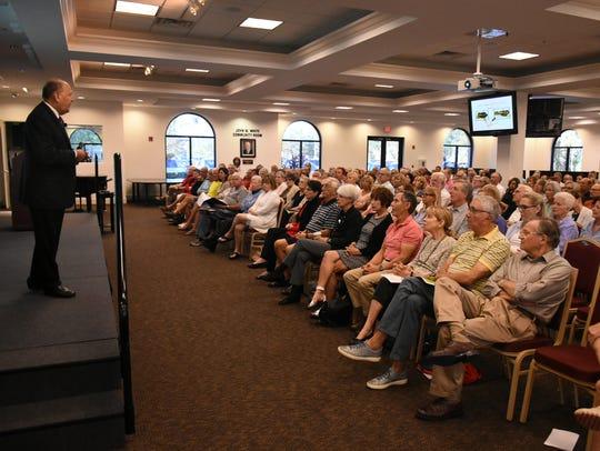 Elliott Katz speaks to a packed hall. He presented