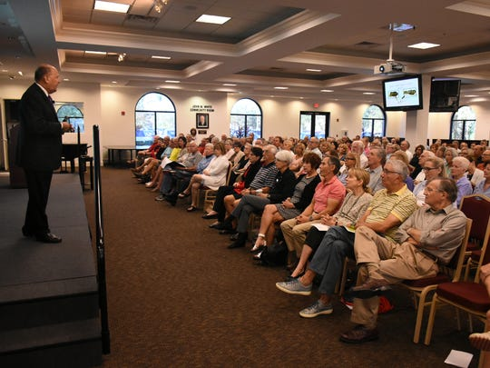 """Elliott Katz speaks to a packed hall. He presented a lecture at Hodges University entitled """"Thank You for the Bomb, Mr. Hitler"""" on Jan. 11, part of a series sponsored by the Holocaust Museum of Southwest Florida."""