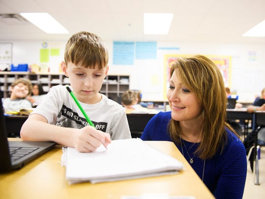Suzanne Billings helps Jackson Mason, 10, with his classwork at Plain Elementary School on Thursday, March 8, 2018.